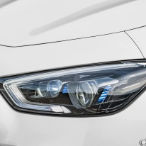 Mercedes-AMG GT 53 4MATIC+ 4-Türer Coupé, AMG Night-Paket, Exterieur: Scheinwerfer, Außenfarbe: designo diamantweiß bright;Kraftstoffverbrauch kombiniert: 9,1 l/100 km; CO2-Emissionen kombiniert: 209 g/km* (vorläufige Daten) Mercedes-AMG GT 53 4MATIC+ 4-Door Coupé, AMG Night-packet, Exterior: Headlight, Exterior paint: designo diamond white bright;Fuel consumption combined: 9.1 l/100 km; CO2 emissions combined: 209g/km* (provisional data)